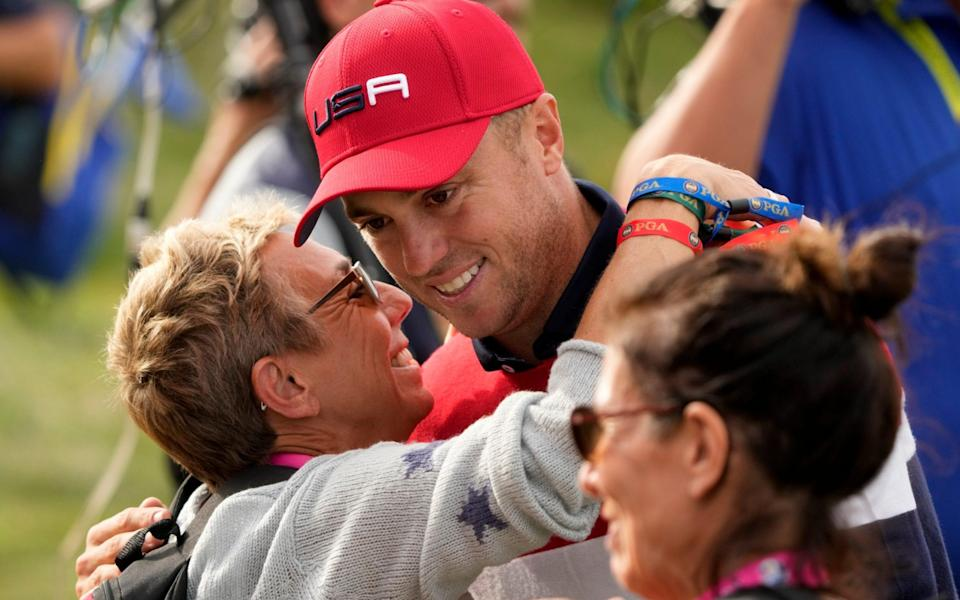Team USA's Justin Thomas gets a hug after winning a Ryder Cup singles match at the Whistling Straits Golf Course - AP