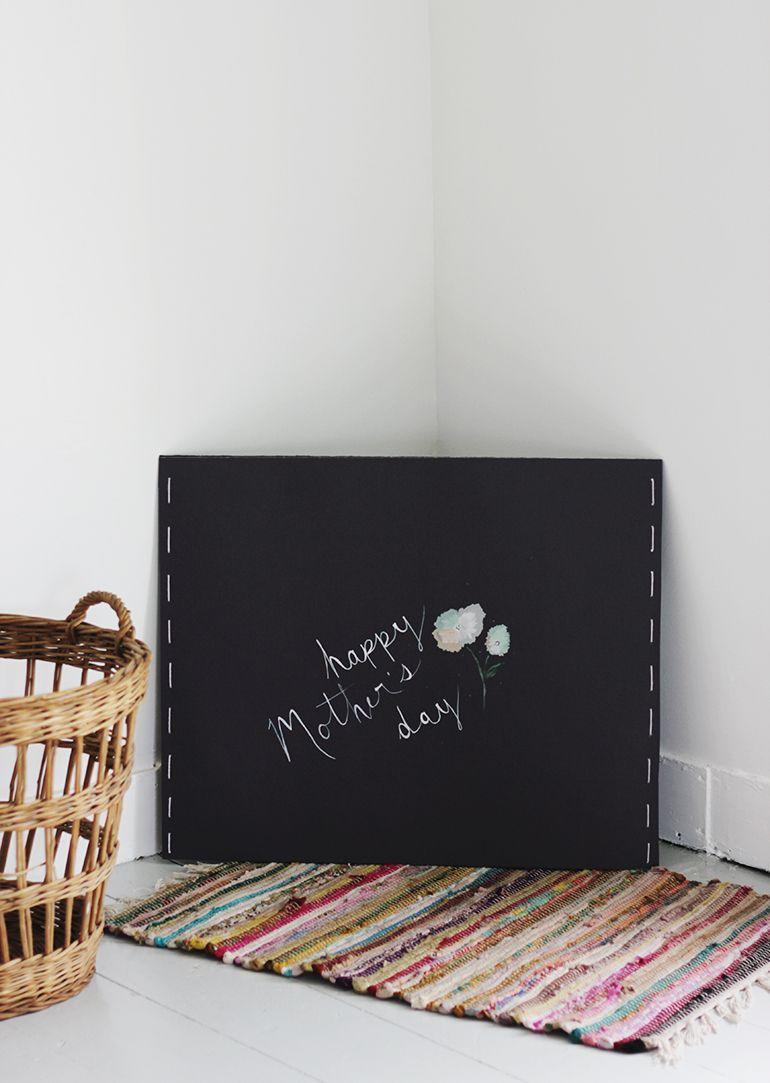 """<p>Could you write a novel about how amazing your mom is? This giant card will give you all the space you need! </p><p><strong>Get the tutorial at <a href=""""https://themerrythought.com/diy/diy-giant-mothers-day-card/"""" rel=""""nofollow noopener"""" target=""""_blank"""" data-ylk=""""slk:The Merrythought"""" class=""""link rapid-noclick-resp"""">The Merrythought</a>. </strong></p><p><a class=""""link rapid-noclick-resp"""" href=""""https://www.amazon.com/Black-Railroad-Board-Thickness-Inches/dp/B08XMNFBDS?tag=syn-yahoo-20&ascsubtag=%5Bartid%7C2164.g.35668391%5Bsrc%7Cyahoo-us"""" rel=""""nofollow noopener"""" target=""""_blank"""" data-ylk=""""slk:SHOP BLACK POSTER BOARD"""">SHOP BLACK POSTER BOARD</a></p>"""