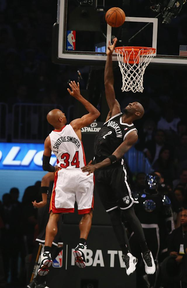 NEW YORK, NY - JANUARY 10: Ray Allen #34 of the Miami Heat is seen with his nickname on his jersey Jesus Shuttlesworth shooting against Kevin Garnett #2 of the Brooklyn Nets during their game at the Barclays Center on January 10, 2014 in New York City. NOTE TO USER: User expressly acknowledges and agrees that, by downloading and or using this photograph, User is consenting to the terms and conditions of the Getty Images License Agreement. (Photo by Al Bello/Getty Images)