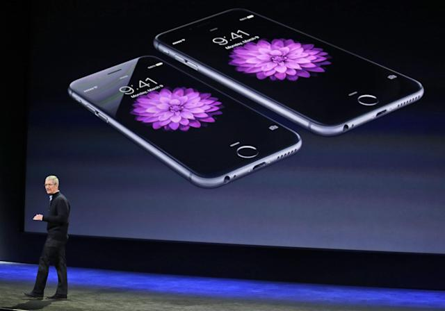 Earnings out of Apple this week will be a highlight for investors as the company closes in on hitting a market cap of $1 trillion. (AP Photo/Eric Risberg)