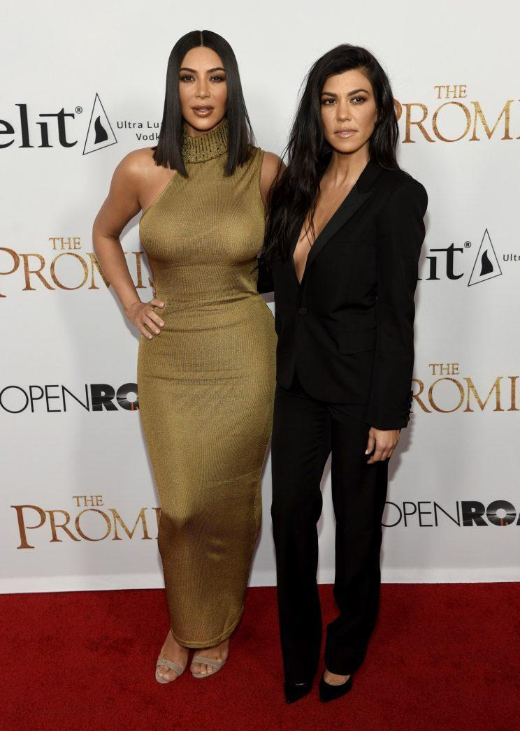 <i>Kim opted for a golden Versace gown [Photo: AP]</i>