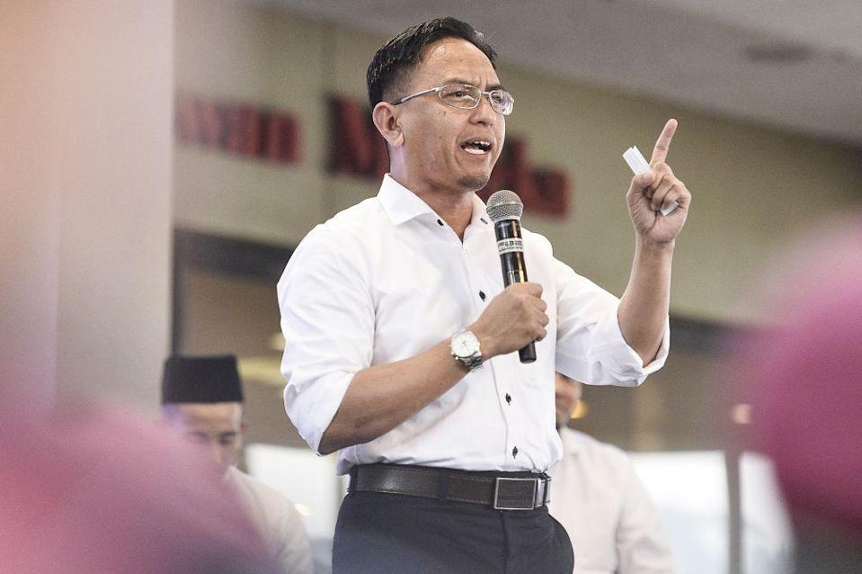 PAS Youth chief Khairil Nizam Khirudin said the party's youth wing was thankful towards DAP's efforts via its Dewan Negara lawmaker Liew Chin Tong in raising the issue of the government's increase of the frequency of special lottery draws for the year 2021. — Picture by Mierza Zulyana