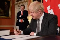Britain's Prime Minister Boris Johnson signs the Brexit trade deal with EU