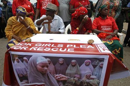 Parents of abducted Chibok girls cry as police denied them access to see President Muhammadu Buhari during a rally in Abuja