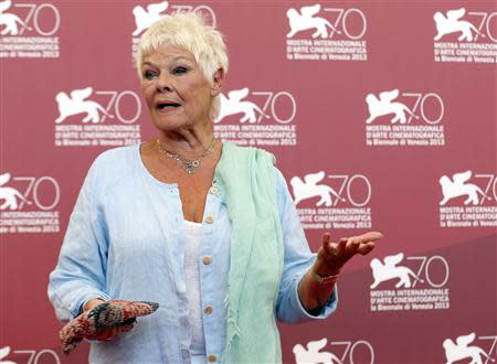 """Actress Dench poses during a photocall for the movie """"Philomena"""", directed by Stephen Frears, during the 70th Venice Film Festival in Venice"""