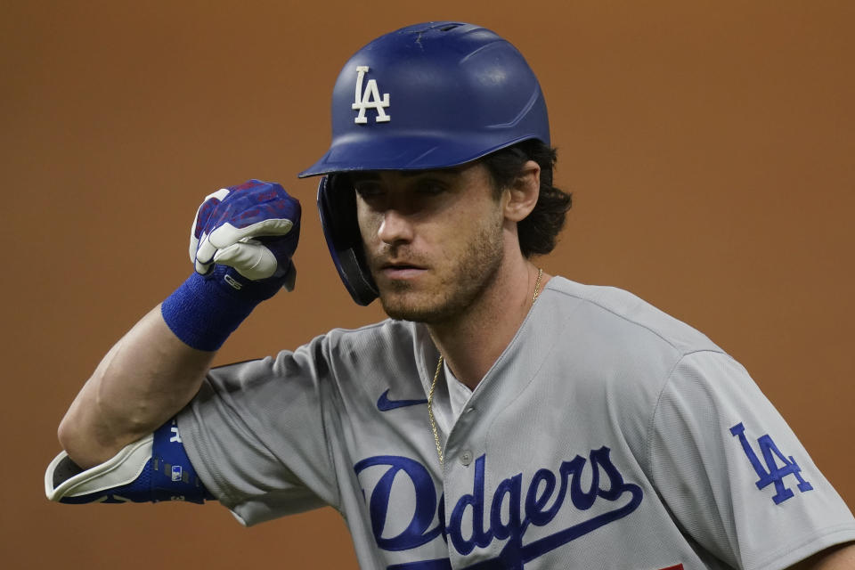 Los Angeles Dodgers' Cody Bellinger celebrates his RBI-single against the Tampa Bay Rays during the first inning in Game 5 of the baseball World Series Sunday, Oct. 25, 2020, in Arlington, Texas. (AP Photo/Eric Gay)