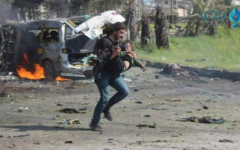 After briefly being knocked unconscious by an explosion outside the Syrian city of Aleppo, activist and journalist Abd Alkader Habak put aside his camera to help wounded children - Aleppo Media Centre