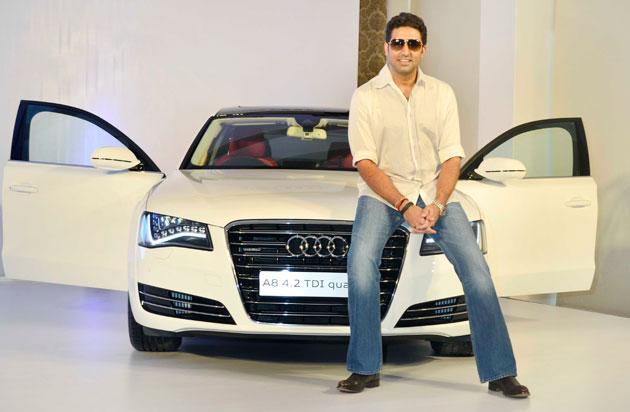 Abhishek Bachchan poses with his new Audi A 8. There were rumours that he had booked it for his baby Aaradhya.