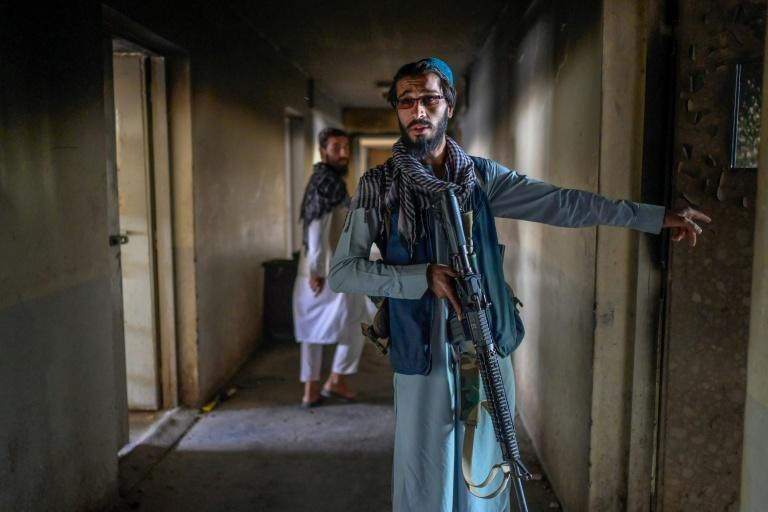 Taliban gunmen who now control Pul-e-Charkhi say the 11 blocks in the main wing each used to house 1,500 inmates (AFP/BULENT KILIC)