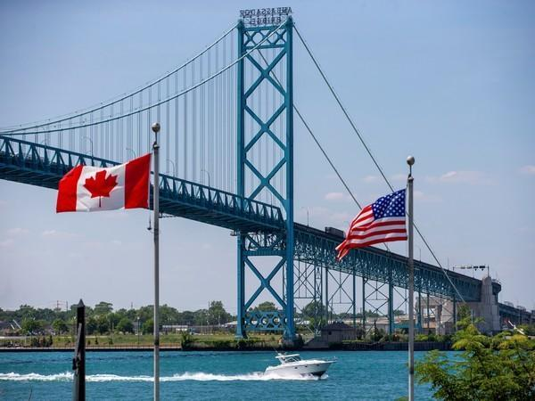 Trucks traverse the Ambassador Bridge, a main trade route linking Canada and the US, July 5, 2020. (Image credit: Reuters)