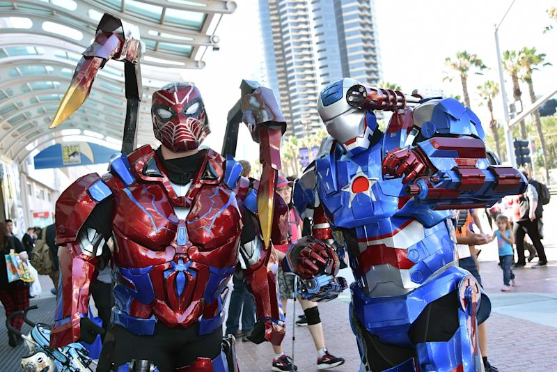 Cosplayers dressed as Transformers walk around San Diego during Comic-Con on July 19, 2019.