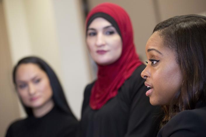 Tamika Mallory, right, at an interview in New York on Jan. 9, 2017, with her fellow Women's March co-chairs Carmen Perez, left, and Linda Sarsour. (AP Photo/Mark Lennihan)