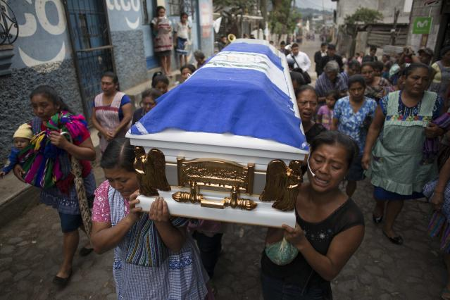 <p>Female family members of Erick Rivas, 20, who died in the hospital after suffering burns from the eruption of the Volcan de Fuego, which in Spanish means Volcano of Fire, carry his remains to the Catholic church to bury him in San Juan Alotenango, Guatemala, Wednesday, June 6, 2018. (Photo: Luis Soto/AP) </p>