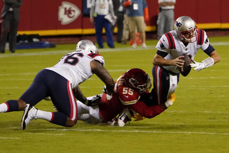 New England Patriots quarterback Brian Hoyer (2) is sacked by Kansas City Chiefs defensive end Frank Clark (55) during the first half of an NFL football game, Monday, Oct. 5, 2020, in Kansas City. (AP Photo/Jeff Roberson)
