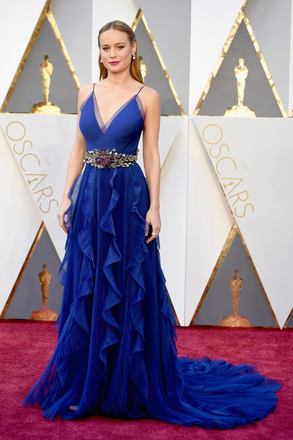 <p>Brie Larson aims to use fashion to reflect what her soul looks like, but if that's the case, then her soul is super-confused. Wearing a busy royal blue dress from Gucci, she accessorized with an encrusted belt, then proceeded to add even more bling with hair jewels. <i>(Photo: Getty Images)</i></p>