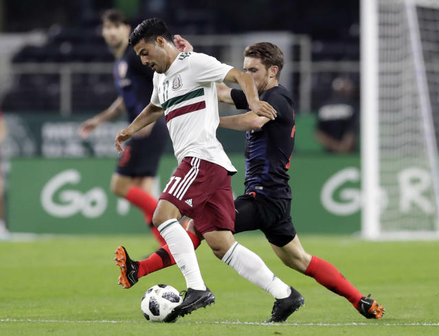 Mexico forward Carlos Vela controls the ball in front of Croatia forward Josip Pivaric (22) in the first half of a friendly soccer match in Arlington, Texas, Tuesday, March 25, 2018. (AP Photo/Tony Gutierrez)