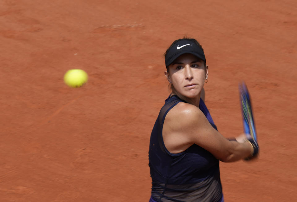 Switzerland's Belinda Bencic plays a return to Russia's Daria Kasatkina during their second round match on day four of the French Open tennis tournament at Roland Garros in Paris, France, Wednesday, June 2, 2021. (AP Photo/Thibault Camus)