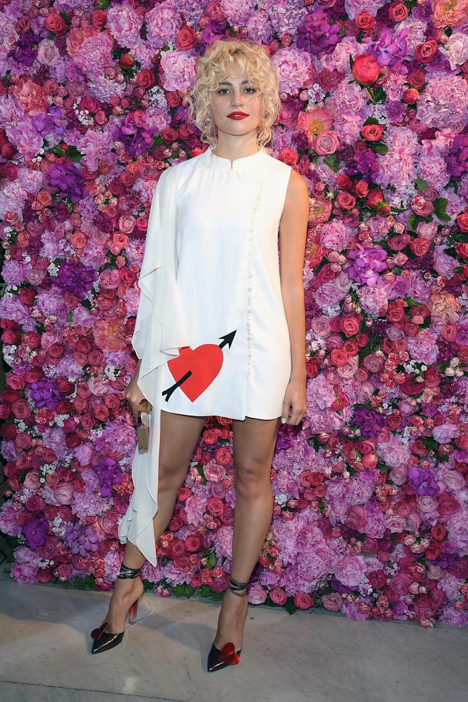 <p>Pixie Lott joined a gaggle of A-listers at the Schiaparelli haute couture show on 2 July in Paris. For the fashionable outing, the singer opted for a mini dress and pop of colour thanks to her co-ordinating lippy. <em>[Photo: Getty]</em> </p>