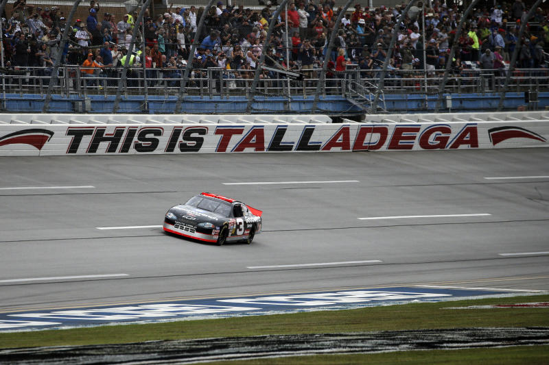 The No. 3 car of the late NASCAR driver Dale Earnhardt Sr., driven by Richard Childress, takes a lap before a NASCAR Cup Series auto race at Talladega Superspeedway in Talladega, Ala., Sunday, Oct. 13, 2019. (AP Photo/Butch Dill)