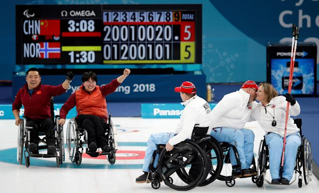 Wheelchair Curling - Pyeongchang 2018 Winter Paralympics - Gold Medal Game - China v Norway - Gangneung Curling Centre - Gangneung, South Korea - March 17, 2018 - Wang Meng of China and Liu Wei of China celebrate after defeating Norway. REUTERS/Carl Recine TPX IMAGES OF THE DAY