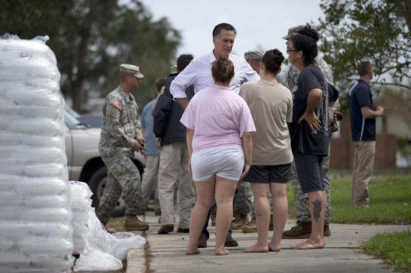 Republican presidential candidate, former Massachusetts Gov. Mitt Romney talks with local residents during a tour of areas flooded hurricane Isaac, Friday, Aug. 31, 2012, in Jean Lafitte, La. (AP Photo/Evan Vucci)