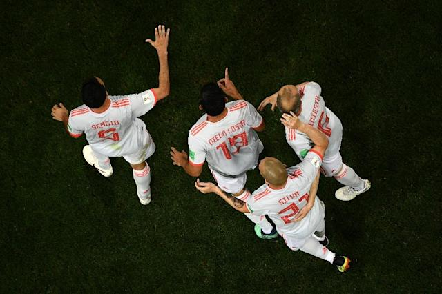 Spain forward Diego Costa (centre) is congratulated by teammates after scoring against Spain (AFP Photo/Jewel SAMAD)