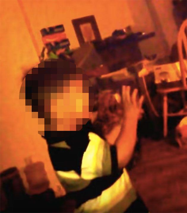 This is the shocking moment the toddler holds his hands up in fear as his mother verbally abuses him. Photo: YouTube