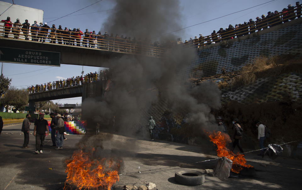 Demonstrators burn tires to protest the postponement of the upcoming presidential election in El Alto, Bolivia, Monday, Aug. 10, 2020. Citing the ongoing new coronavirus pandemic, the nation's highest electoral authority delayed presidential elections from Sept. 6 to Oct. 18, the third time the vote has been delayed. (AP Photo/Juan Karita)