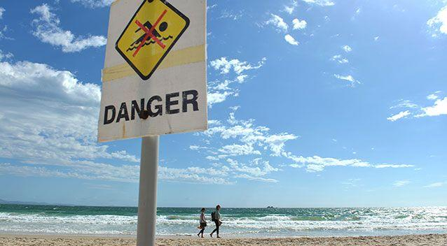 A sign warning swimmers at Byron Bay not to go in the water during a scare in 2014. Source: AAP