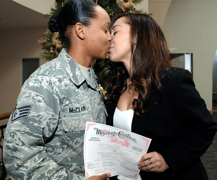 Staff Sgt. Aisha McClain, left, and Shannelle Williams kiss after getting married at the Doña Ana County Government Center on Thursday, Dec. 19, 2013, in Las Cruces, N.M. The New Mexico's highest court declared it was unconstitutional to deny marriage licenses to gay and lesbian couples. (AP Photo/The Las Cruces Sun-News, Robin Zielinski)