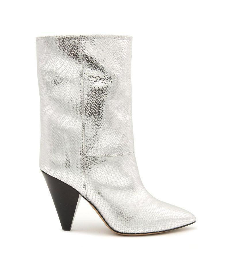 """<p><strong>Isabel Marant </strong></p><p>ShopBAZAAR.com</p><p><strong>$1155.00</strong></p><p><a href=""""https://go.redirectingat.com?id=74968X1596630&url=https%3A%2F%2Fshop.harpersbazaar.com%2Fdesigners%2Fisabel-marant-shoes%2Flocky-low-boot-in-silver-70797.html&sref=https%3A%2F%2Fwww.harpersbazaar.com%2Ffashion%2Ftrends%2Fg35556071%2Ffall-2021-shoe-trends%2F"""" rel=""""nofollow noopener"""" target=""""_blank"""" data-ylk=""""slk:Shop Now"""" class=""""link rapid-noclick-resp"""">Shop Now</a></p><p>After a year without traveling, a trip to outer space is long overdue. Our packing list includes freeze-dried food, puffy outerwear, and, of course, a metallic boot. With how fast this trend has picked up, we're calling silver the new neutral.</p>"""