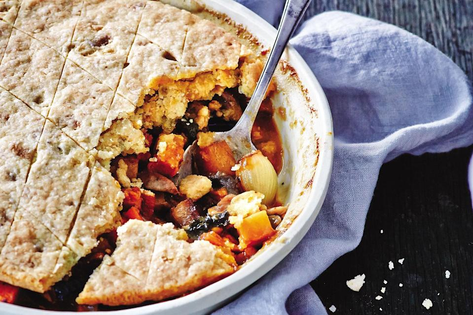"""Sweet potatoes, rutabagas, and kale provide the vegetable base of this pot pie, which is bulked up with boneless, skinless chicken thighs. For a sweet and toasty Southern touch, add a small amount of cornmeal to the crust. <a href=""""https://www.epicurious.com/recipes/food/views/chicken-thigh-potpie-56390147?mbid=synd_yahoo_rss"""" rel=""""nofollow noopener"""" target=""""_blank"""" data-ylk=""""slk:See recipe."""" class=""""link rapid-noclick-resp"""">See recipe.</a>"""