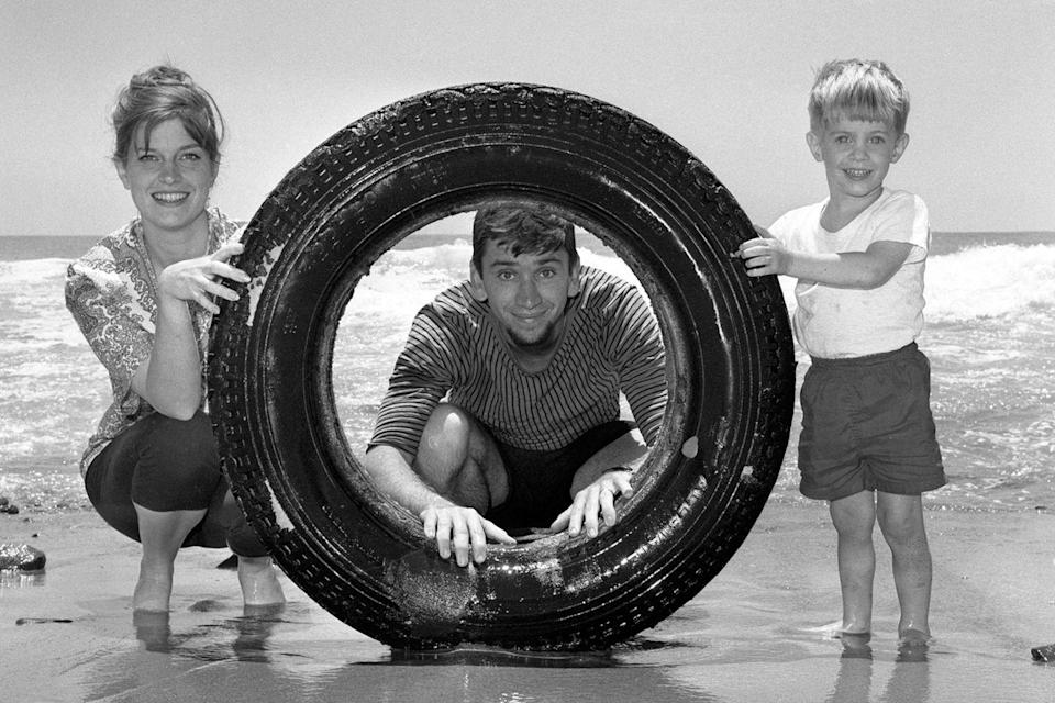 <p>Bob Denver has a little beach day fun with his family and an inflatable in Malibu Beach.</p>