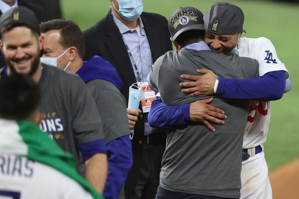ARLINGTON, TEXAS - OCTOBER 27:  Mookie Betts #50 and President Andrew Friedman of the Los Angeles Dodgers celebrate after defeating the Tampa Bay Rays 3-1 in Game Six to win the 2020 MLB World Series at Globe Life Field on October 27, 2020 in Arlington, Texas. (Photo by Tom Pennington/Getty Images)