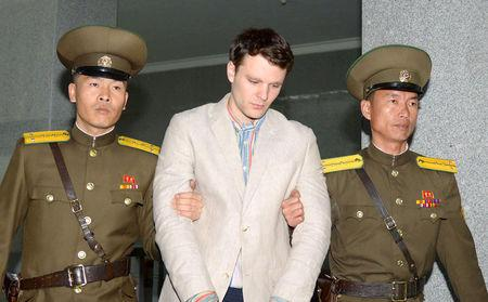 FILE PHOTO: Otto Frederick Warmbier (C), a University of Virginia student who was detained in North Korea since early January, is taken to North Korea's top court in Pyongyang, North Korea, in this photo released by Kyodo March 16, 2016.    Mandatory credit Kyodo/via REUTERS