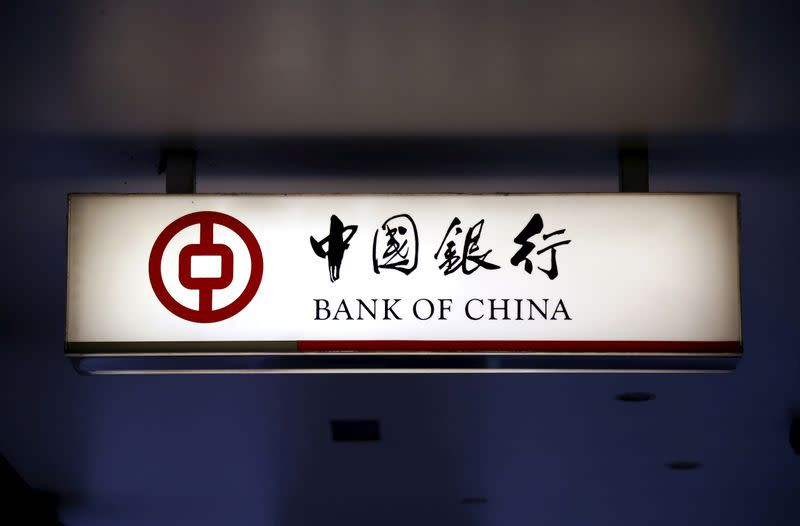 FILE PHOTO: An illuminated sign for the Bank of China is displayed outside a branch in central Sydney, Australia