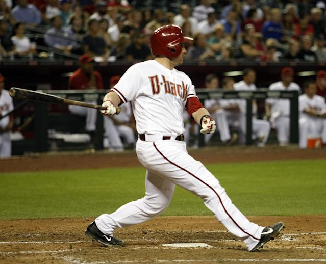 Arizona Diamondbacks catcher Miguel Montero (26) hits an RBI single in the third inning during a baseball game against the Washington Nationals, Monday, May 12, 2014, in Phoenix. (AP Photo/Rick Scuteri)