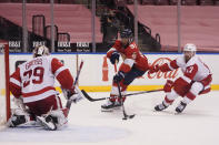 Florida Panthers left wing Anthony Duclair (91) attempts a shot against Detroit Red Wings goaltender Thomas Greiss (29) and defenseman Filip Hronek (17) during the second period of an NHL hockey game, Sunday, Feb. 7, 2021, in Sunrise, Fla. (AP Photo/Wilfredo Lee)