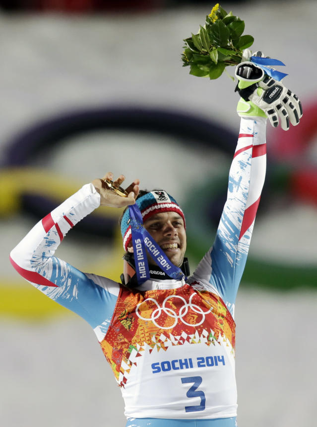 Men's slalom winner, Austria's Mario Matt, holds his gold medal as he celebrates on the podium at the Sochi 2014 Winter Olympics, Saturday, Feb. 22, 2014, in Krasnaya Polyana, Russia. (AP Photo/Gero Breloer)