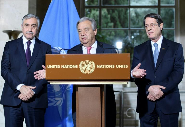 UN Secretary General Antonio Guterres (C) speaks as Turkish Cypriot leader Mustafa Akinci (L) and Greek Cypriot leader Nicos Anastasiades (R) listen on during a press conference following Cyprus peace talks in Geneva on January 12, 2017