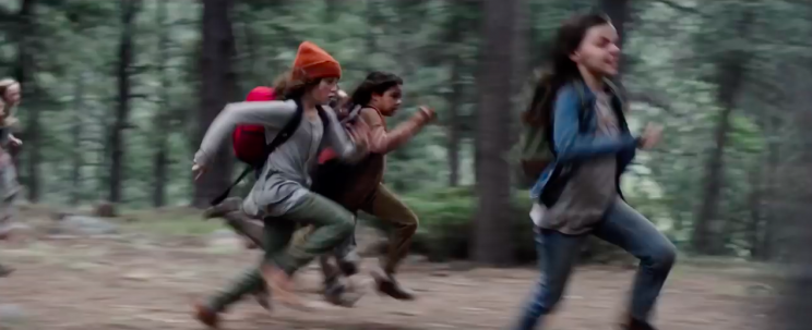 Laura (right) and her fellow new mutants on the run in <em>Logan</em>. (Photo: 20th Century Fox)