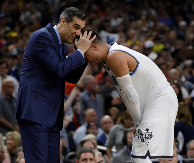 Villanova head coach Jay Wright hugs Jalen Brunson as they celebrate after the championship game of the Final Four NCAA college basketball tournament against Michigan, Monday, April 2, 2018, in San Antonio. Villanova won 79-62.(AP Photo/David J. Phillip)