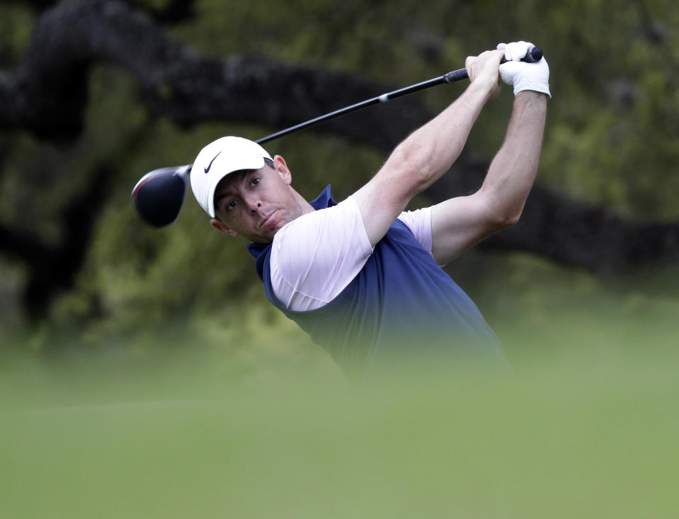 Rory McIlroy watches his drive on the eighth hole during round-robin play at the Dell Technologies Match Play Championship golf tournament, Friday, March 29, 2019, in Austin, Texas. (AP Photo/Eric Gay)