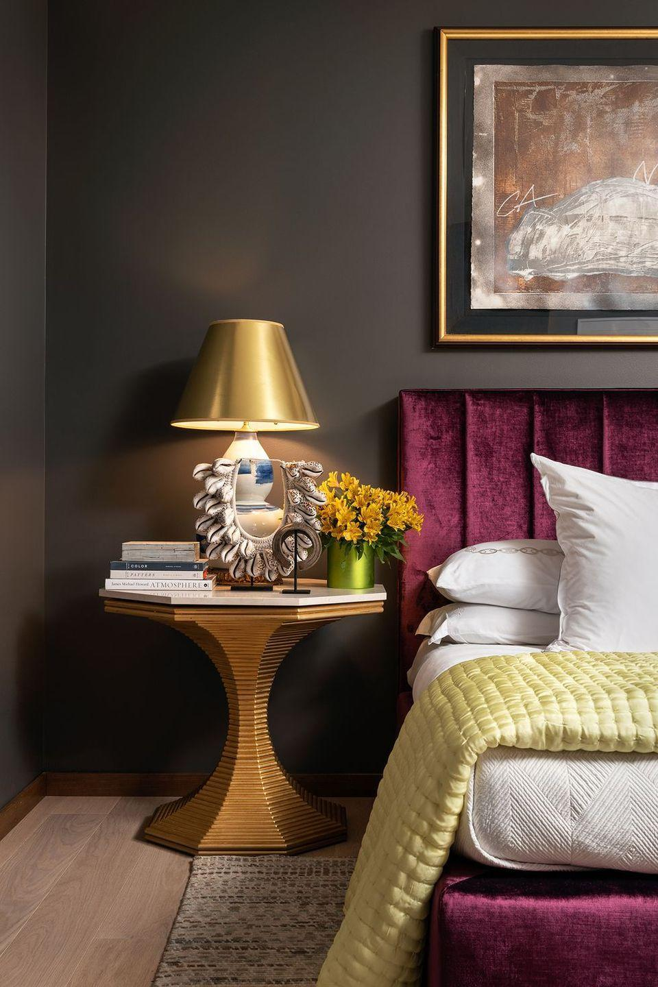 """<p>Dark hues can make a big impact, and this project from interior designer <a href=""""https://www.gaildavisdesignsllc.com/"""" rel=""""nofollow noopener"""" target=""""_blank"""" data-ylk=""""slk:Gail Davis"""" class=""""link rapid-noclick-resp"""">Gail Davis</a> is proof. """"I had the opportunity to use this expressive color in a guest bedroom for a private residence in Princeton, New Jersey. This color did not disappoint, being the perfect backdrop for the headboard and artwork. It takes your breath away.""""</p><p><a class=""""link rapid-noclick-resp"""" href=""""https://www.paintoutlets.com/products/z5-darjeeling"""" rel=""""nofollow noopener"""" target=""""_blank"""" data-ylk=""""slk:SHOP NOW"""">SHOP NOW</a></p>"""