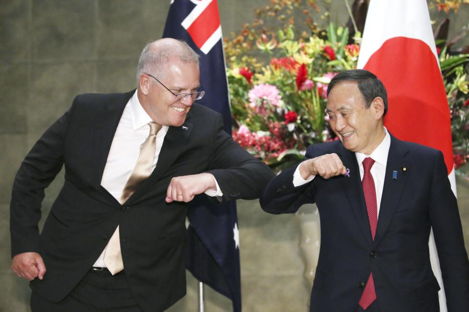 New Japanese Prime Minister Yoshihide Suga greets Australian PM Scott Morrison in Tokyo on Tuesday. Source: AAP
