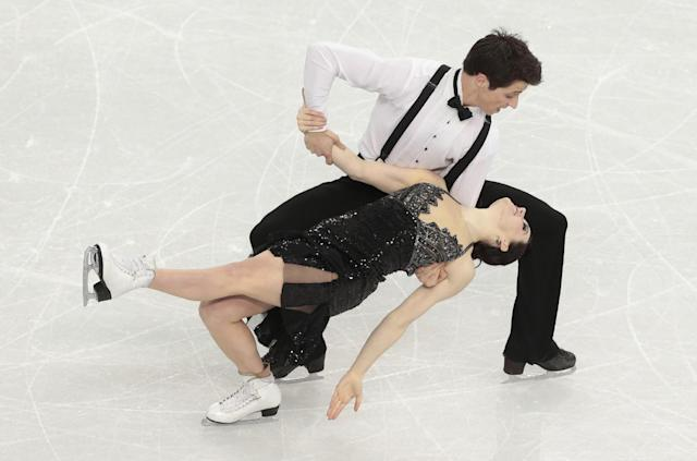 Tessa Virtue and Scott Moir of Canada compete in the ice dance short dance figure skating competition at the Iceberg Skating Palace during the 2014 Winter Olympics, Sunday, Feb. 16, 2014, in Sochi, Russia