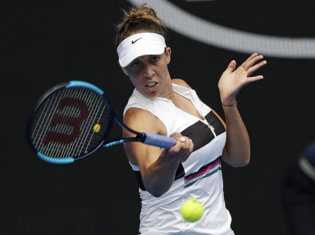 United States' Madison Keys hits a forehand return to Australia's Destanee Aiava during their first round match at the Australian Open tennis championships in Melbourne, Australia, Tuesday, Jan. 15, 2019. (AP Photo/Kin Cheung)