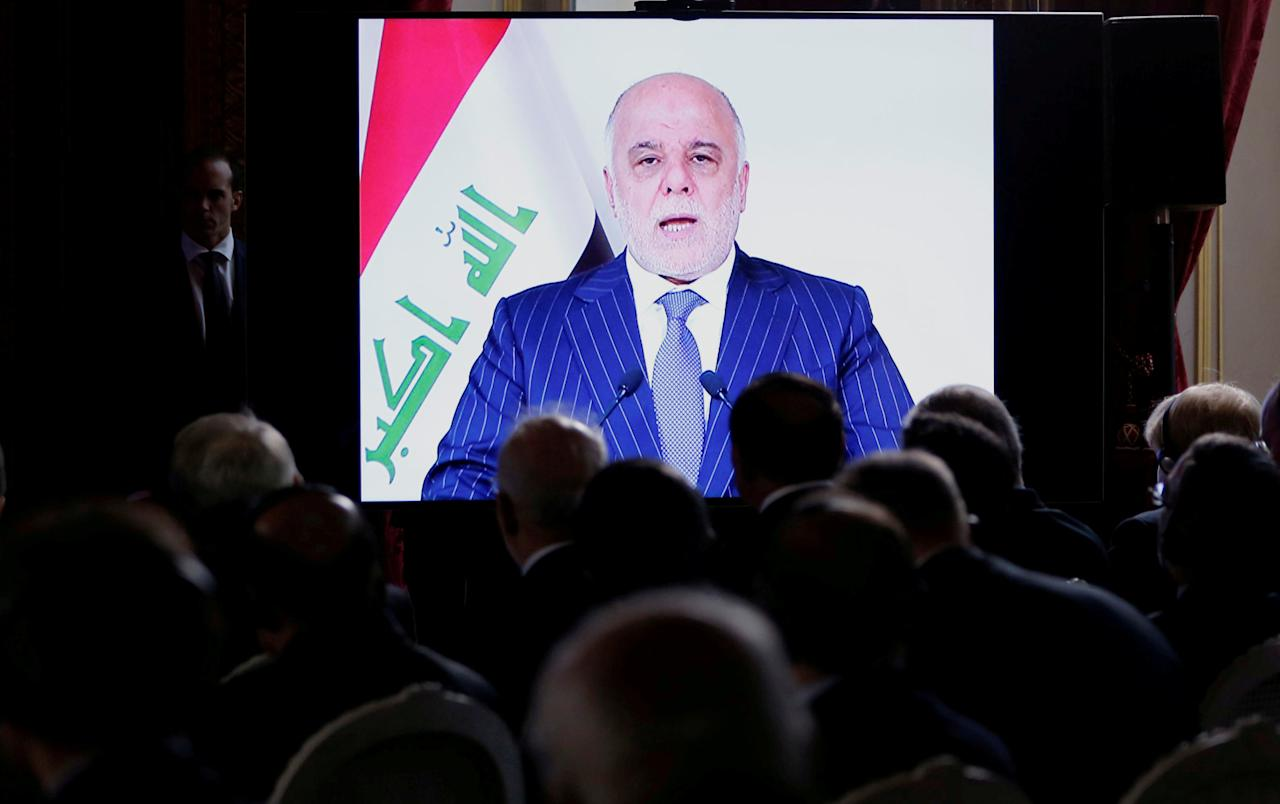 Iraqi Prime Minister Haider al-Abadi is seen on a screen as he speaks via a videoconference during a ministerial summit to hold discussion on the future of Mosul city, post-Islamic State, in Paris, France, October 20, 2016.  To match Insight MIDEAST-CRISIS/MILITIAS    REUTERS/Regis Duvignau/File Photo
