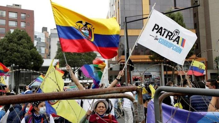 Supporters of Ecuador's presidential candidates Yaku Perez and Guillermo Lasso gather outside the Electoral National Council (CNE) in Quito, Ecuador, February 12, 2021