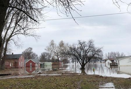 Homes sit in flood waters after leaving casualities and causing hundreds of millions of dollars in damages, with waters yet to crest in parts of the U.S. midwest, in Peru, Nebraska, U.S., March 19, 2019.  REUTERS/Karen Dillon